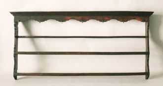 AN 18TH CENTURY OAK TRIPLE DELFT RACK, with moulded cornice and wrought iron hooks. 5ft 8ins long