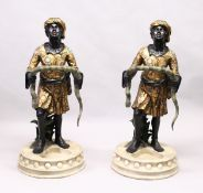 A PAIR OF COLOURFUL BLACKAMOOR STICK STANDS.