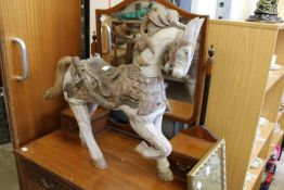 A small carved and painted model of a horse.