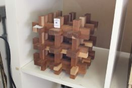 A wooden puzzle (?).