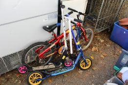 A child's bike and four scooters.
