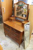 An Edwardian mahogany dressing chest.
