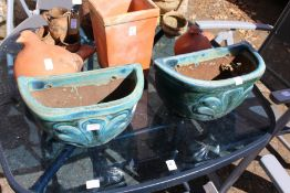 A pair of glazed wall planters.