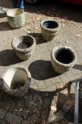 A set of four reconstituted stone garden pots.