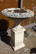 A good large classical style reconstituted stone pedestal urn on stand.