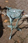 A small cast metal urn stand.