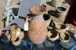 A terracotta jug and two small garden urn shaped planters.