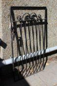 A wrought iron garden gate.