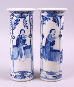 A PAIR OF CHINESE KANGXI BLUE & WHITE PORCELAIN SLEEVE VASES, both decorated with scenes of