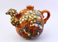 A LARGE CHINESE SANCAI GLAZED TANG STYLE POTTERY EWER, with carved and moulded decoration of a