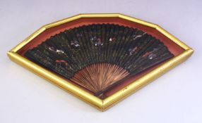 A GOOD 19TH / 20TH CENTURY FRAMED CHINESE WOOD AND PAINTED PAPER FAN, the fan decorated with