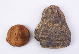 TWO GOOD EARLY TIBETAN AMULETS, both with figures of buddha, 8cm x 4cm.