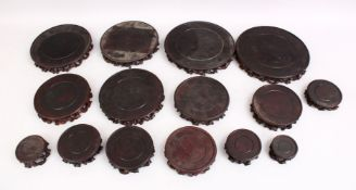 A MIXED LOT OF 19TH CENTURY CHINESE CARVED HARDWOOD STANDS, comprising of fifteen various shaped and