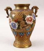 A JAPANESE CLOISONNE ENAMEL TWIN HANDLED VASE, decorated to depict floral display, 21.5cm high