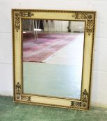 A FRENCH EMPIRE REVIVAL MIRROR, EARLY 20TH CENTURY, with painted and gilt decorated frame. 2ft