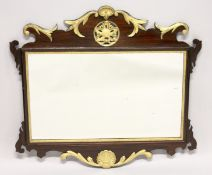 A GOOD GEORGE III DESIGN MAHOGANY FRETWORK FRAME WALL MIRROR, with pierced, carved and gilded frame.