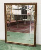 A DECORATIVE WALL MIRROR, with bevelled mirror plates. 3ft 2.5ins x 2ft 4.5ins.