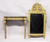 AN 18TH CENTURY ITALIAN GILTWOOD CONSOLE AND MIRROR, the mirror with pierced frieze basket and