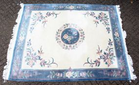 A GOOD LARGE MODERN CHINESE CARPET, beige ground with central floral motif within a similarly