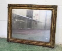AN 18TH/19TH CENTURY GILT FRAMED MIRROR, the frame with moulded floral decoration and original