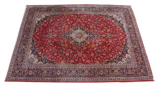A GOOD LARGE KASHAN CARPET, 20TH CENTURY, claret ground with allover floral decoration. 13ft 0ins