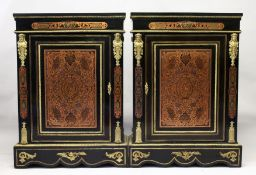 A VERY GOOD PAIR OF 19TH CENTURY EBONY, ORMOLU AND ENGRAVED BRASS PIER CABINETS, each having a