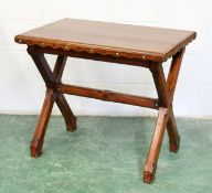 """AN ARTS AND CRAFTS PITCH PINE TABLE, rectangular top, """"X"""" framed support inset with coloured"""