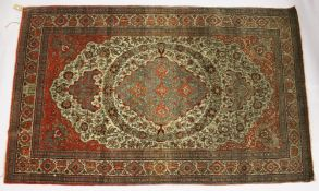 A GOOD PERSIAN RUG, EARLY 20TH CENTURY, beige ground, with floral decoration, signed. 7ft 6ins x 4ft