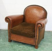 A 1930'S BROWN LEATHER UPHOLSTERED ARMCHAIR. 2ft 7ins high x 2ft 11ins wide.