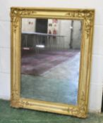 A 19TH CENTURY FRENCH GILT FRAMED MIRROR, with decorative moulded corners and original glass. 2ft