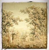 A BRUSSELS STYLE TAPESTRY WALL HANGING, depicting figures in a parkland setting (AF). 8ft 4ins