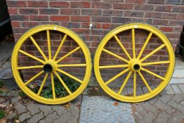 A large pair of painted cartwheels.