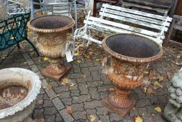 A good large pair of cast iron campagna shaped garden urns.