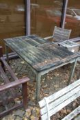 A wooden garden table.