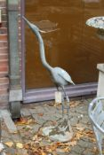 A good lead model of a standing heron.
