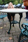 A Victorian pub style circular cast iron table.