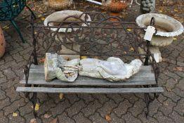 A cast iron garden bench.