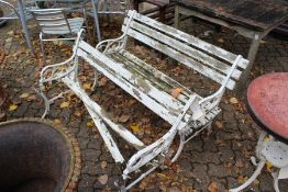 A pair of cast iron and wooden slatted garden benches (AF).