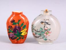TWO 19TH / 20TH CENTURY CHINESE SNUFF BOTTLES, one porcelain with coral ground and decoration of