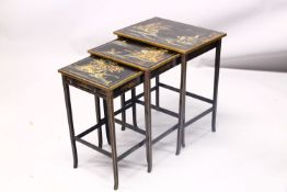 A 19TH CENTURY CHINESE LACQUER DECORATED NEST OF TABLES, decorated with views of landscapes and