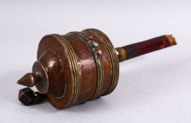 A 19TH CENTURY TIBETAN PRAYER WHEEL - containing a manuscript, with inlaid semi precious stones,