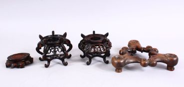A MIXED LOT OF 19TH / 20TH CENTURY CARVED CHINESE HARDWOOD STANDS, each of varying size and style.