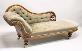 A VICTORIAN MAHOGANY CHAISE LONGUE, with carved and pierced frame, on turned and carved feet with