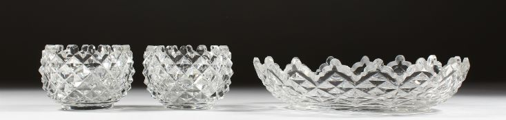 AN OVAL CUT GLASS DISH and a pair of oval salts (3).