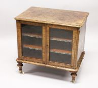 A VICTORIAN WALNUT LOW TWO DOOR MUSIC CABINET, with two shelves, on turned feet. 2ft 3ins wide x 2ft