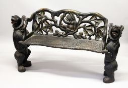 "A ""BLACK FOREST"" CARVED WOOD BENCH SEAT, the naturalistically carved seat with a bear being"