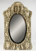A GOOD DIEPPE PRISONER OF WAR CARVED BONE MIRROR, CIRCA. 1860, with emblems, shields, etc., with