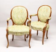 A GOOD PAIR OF FRENCH BEECH WOOD ARMCHAIRS with padded back and seats.