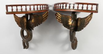 A GOOD UNUSUAL PAIR OF 19TH CENTURY MAHOGANY CORNER WALL SHELVES, the galleried tops supported by