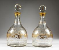 A VERY GOOD PAIR OF GEORGIAN MALLET DECANTERS AND STOPPERS, with gilt decoration, ribbons, etc.